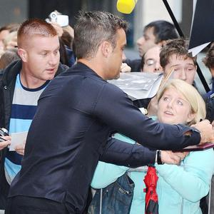Robbie Williams arrives at Radio 1 in London