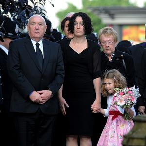 Paul Bone, left, wife June, right, the parents of murdered Pc Fiona Bone, stand outside Manchester Cathedral with her partner Clare and Clare's daughter Jessie