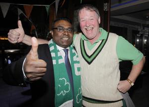Ireland cricketer Kevin O'Brian's friends Rangan Arulchelvan (left) and Dick Forrest celebrates Ireland's victory over England in their ICC Cricket World Cup match, during a post match party at Krystal night Club, Dublin