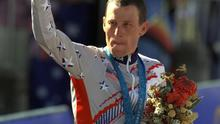 U S cyclist Lance Armstrong waves after receiving the bronze medal in the men's individual time trials at the 2000 Summer Olympics cycling road course in Sydney, Australia. Officials familiar with the decision tell The Associated Press the IOC has stripped Armstrong of his bronze medal from the 2000 Sydney Olympics because of his involvement in doping. Two officials say the IOC sent a letter to Armstrong on Wednesday night, Jan. 16, 2013,  asking him to return the medal.  (AP Photo/Ricardo Mazalan, File)