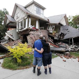 Murray and Kelly James look at their destroyed house in central Christchurch, New Zealand (AP/Mark Baker)
