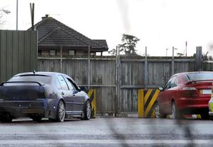 Two cars in a sealed off area outside the entrance to Massereene army base after the  fatal shootings.
