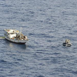A pirate vessel is boarded by Royal Marines in the Indian Ocean (Royal Navy/MoD/PA)