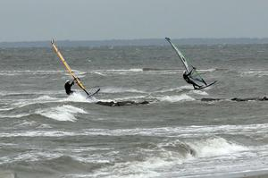 FAIRFIELD, NY - OCTOBER 28: Windsurfers take advantage of the weather as the first signs of Hurricane Sandy approach on October 28, 2012 in Fairfield, Connecticut. The storm, which could affect tens of millions of people in the eastern third of the U.S., is expected to bring days of rain, high winds and possibly heavy snow in parts of Ohio and West Virginia. New York Governor Andrew Cuomo announced that New York City will close its bus, subway and commuter rail service Sunday evening ahead of the storm.  (Photo by Spencer Platt/Getty Images)