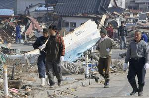 Residents head to search for missing people in Yamada, northern Japan Monday, March 14, 2011 following Friday's massive earthquake and the ensuing tsunami. (AP Photo/Kyodo News)  JAPAN OUT, MANDATORY CREDIT, NO SALES IN CHINA, HONG  KONG, JAPAN, SOUTH KOREA AND FRANCE