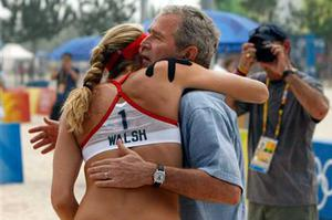 President Bush hugs Kerri Walsh as he visits the practice of the U.S. beach volleyball team at the 2008 Summer Olympic games in Beijing, China Saturday, Aug. 9, 2008.