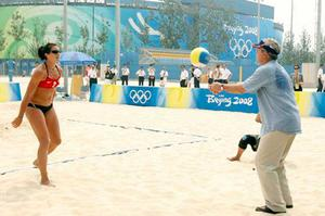 President Bush plays vollyball with Misty May Treanor as he visits the practice of the U.S. beach volleyball team at the 2008 Summer Olympic games in Beijing, China Saturday, Aug. 9, 2008.
