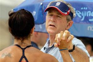 U.S. President George Bush shakes hands with with U.S. beach volleyball player Misty May Treanor at the Chaoyang Park Beach Volleyball Ground at the Beijing 2008 Olympics in Beijing, Saturday, Aug. 9, 2008.