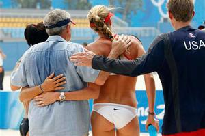 President Bush poses for a photo with Misty May Treanor, left, Kerri Walsh and trainer Ernest Ferrel as he visits the practice of the U.S. beach volleyball team at the 2008 Summer Olympic games in Beijing, China Saturday, Aug. 9, 2008.