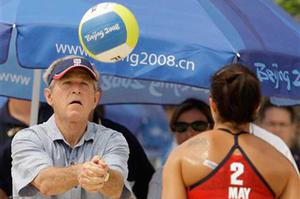 U.S. President George Bush practices with US player Misty May Treanor at the Chaoyang Park Beach Volleyball Ground at the Beijing 2008 Olympics in Beijing, Saturday, Aug. 9, 2008.