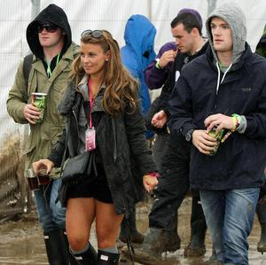 Wayne and Coleen Rooney with Wayne's brother John, right, backstage at Glastonbury