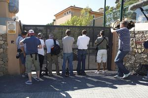 Journalists photograph the entrance of the hotel where members of the group Boyzone are staying in Port Andratx in Mallorca