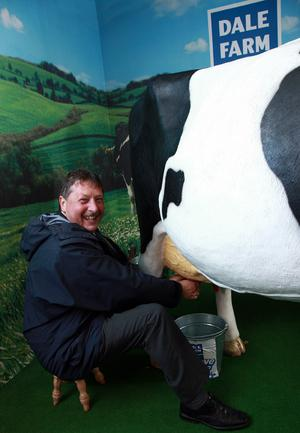 Sammy Wilson, proved to be dairy good when he tried his hand at milking Daisy the Dale Farm Cow at the Balmoral Show