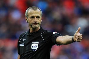 LONDON, ENGLAND - APRIL 15:  Referee Martin Atkinson signals during the FA Cup with Budweiser Semi Final match between Tottenham Hotspur and Chelsea at Wembley Stadium on April 15, 2012 in London, England.  (Photo by Michael Steele/Getty Images)