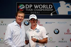 DUBAI, UNITED ARAB EMIRATES - NOVEMBER 20:  George O'Grady, Chief Executive of The European Tour, (left) presents Rory McIlroy of Northern Ireland with his 2013 Members' Clip as a celebration of his victory in the 2012 Race To Dubai at the Dubai World Championship on the Earth Course at Jumeirah Golf Estates on November 20, 2012 in Dubai, United Arab Emirates.  (Photo by Andrew Redington/Getty Images)