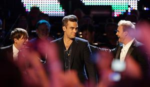 Robbie Williams and Take That member Mark Owen and Gary Barlow as Robbie joins his ex-band mates on stage for a special performance