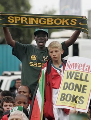 South African rugby fans react to the arrival of the Springbok team at Johannesburg's O. R. Tambo airport, Tuesday, Oct. 23, 2007. A sea of green and gold greeted South Africa's victorious rugby team on its return home Tuesday after winning the Rugby World Cup in France. South Africa beat England 15-6 in a convincing win in Paris on Saturday.