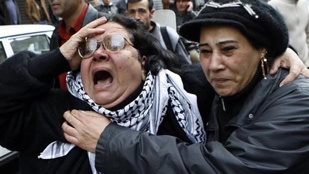 A Palestinian woman cries during a protest in Damascus, Syria on Saturday Dec. 27, 2008 against an Israeli raid on Gaza that killed some 145 Palestinians. Israeli warplanes attacked dozens of security compounds across Hamas-ruled Gaza on Saturday in unprecedented waves of air strikes. Gaza medics said at least 145 people were killed and more than 310 wounded in the single deadliest day in Gaza fighting in recent memory.   (AP Photo/Bassem Tellawi)