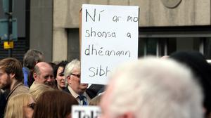 A sign reading 'not in our name' at the peace rally held at the City Hall in Belfast in response to the murder of Constable Ronan Kerr