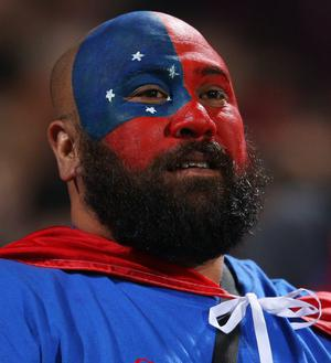 AUCKLAND, NEW ZEALAND - SEPTEMBER 30:  Samoan fans show their colours during the IRB 2011 Rugby World Cup Pool D match between South Africa and Samoa at North Harbour Stadium on September 30, 2011 in Auckland, New Zealand.  (Photo by David Rogers/Getty Images)