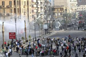 Egyptians protestors clash with anti-riot policemen in Suez, Egypt, Thursday, Jan.27, 2011. Egyptian activists protested for a third day as social networking sites called for a mass rally in the capital Cairo after Friday prayers, keeping up the momentum of the country's largest anti-government protests in years. (AP Photo)