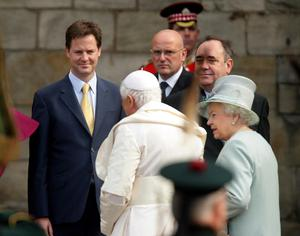 Queen Elizabeth II meets Pope Benedict XVI as Deputy Prime Minister Nick Clegg (left) and First Minister of Scotland Alex Salmond (right) watch on at the Palace of Holyroodhouse in Edinburgh on the first day of his four day visit to the United Kingdom
