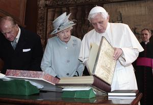 Britain's Queen Elizabeth II exchanges gifts with Pope Benedict XVI during an audience in the Morning Drawing Room at the Palace of Holyroodhouse in Edinburgh