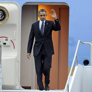 US President Barack Obama arrives at the Bradley Air National Guard Base in East Granby, Connecticut, ahead of a vigil (AP)