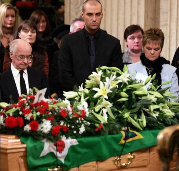 George Best's coffin is draped with the Northern Ireland flag