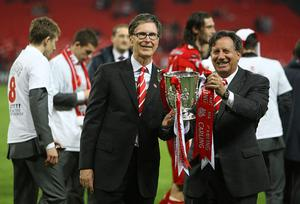 Liverpool owner John W Henry (left) and Chairman Tom Werner (right) celebrate with the Carling Cup Trophy during the Carling Cup Final at Wembley Stadium, London