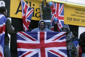 Loyalist hold protest at Naomi Long's east Belfast Alliance office following a council vote last night which will see the Union Flag only follow certain days.  Loyalist protesters pictured on the Newtownards Road during the protest