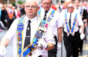 12/7/11 Mandatory Credit Darren Kidd/Presseye.com Orangemen take part in Twelfth of July parades as they make their way to the field at Shaws Bridge, Belfast.The parade makes its way along Dublin Rd, LOL 59