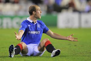Steven Whittaker of Rangers reacts during their UEFA Champions League group C match with Valencia