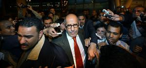 CAIRO, EGYPT - JANUARY 27: Egyptian opposition leader Mohamed ElBaradei is surrounded by reporters as he arrives at Cairo airport on January 27, 2011 in Cairo, Egypt. ElBaradei has vowed to join anti government protesters in Cairo tomorrow.  (Photo by Peter Macdiarmid/Getty Images)  ***BESTPIX***