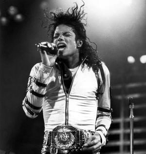 "Michael Jackson performs on stage during his ""BAD"" concert tour held at Wembley Stadium ,London on the 15th of July 1988.While performing in London, England Michael breaks a world record (as shown in the Guinness Book Of World Records) with 504,000 people attending 7 sold out shows at Wembley Stadium, more than any other artist."