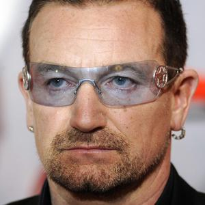 U2 have had to postpone tour dates after Bono injured his back
