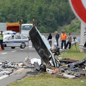 Police survey the scene of the bus crash near Gospic, Croatia, where at least seven Czech tourists were killed (AP)