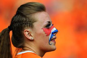 KHARKOV, UKRAINE - JUNE 09:  A Dutch fan soaks up the atmopshere prior to the UEFA EURO 2012 group B match between Netherlands and Denmark at Metalist Stadium on June 9, 2012 in Kharkov, Ukraine.  (Photo by Lars Baron/Getty Images)