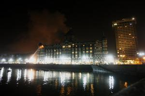 Fire engulfs a part of the Taj Mahal Hotel as firemen try to douse it in Mumbai, India, Wednesday, Nov. 26, 2008. Teams of heavily armed gunmen stormed luxury hotels, a popular restaurant, hospitals and a crowded train station in coordinated attacks across India's financial capital Wednesday night, killing at least 78 people and taking Westerners hostage, police said. A previously unknown group, apparently Muslim militants, took responsibility for the attacks.   (AP Photo/Gautam Singh)