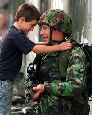 August 1994 A young boy and soldier on the Springfield Road in west Belfast Picture by Pacemaker