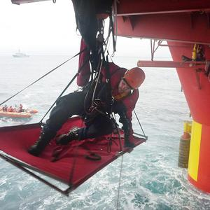 A Greenpeace campaigner scales the Cairn Energy oil rig off Greenland