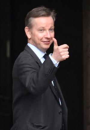 Conservative Party education spokeman Michael Gove gestures to a colleague at Parliament on May 10, 2010 in London, England