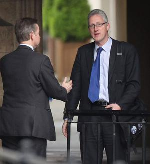 Conservative Party education spokeman Michael Gove (L) talks with former Liberal Democrat MP Lembit Opik at Parliament on May 10