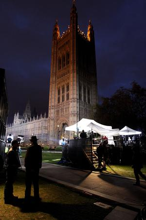 Television crews conduct interviews with politicians and journalists into the night adjacent to the Houses of Parliament on May 10, 2010