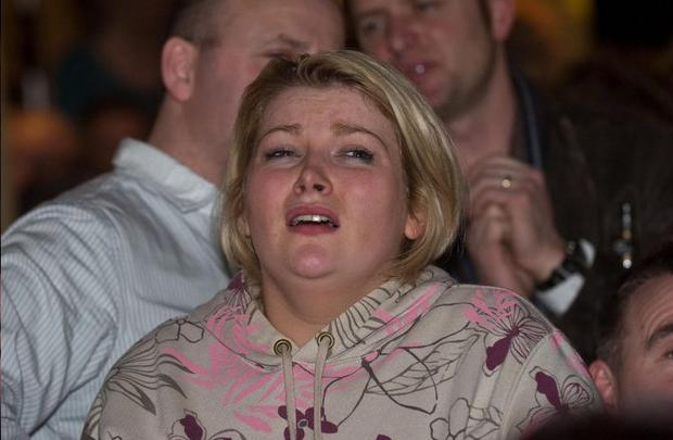 An X Factor fan crys after hearing that Eoghan Quigg was voted from the show