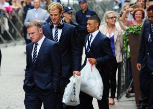 England's Wayne Rooney (left), Joe Hart (centre) and Alex Oxlade-Chamberlain leave the Team hotel today in Krakow, Poland