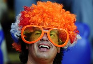 A Netherlands fan cheers prior to the Euro 2012 soccer championship Group B match between the Netherlands and Germany in Kharkiv, Ukraine, Wednesday, June 13, 2012. (AP Photo/Manu Fernandez)