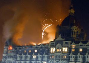 The Taj Hotel, Mumbai's landmark hotel, is caught fire after an attack in Mumbai, India's financial capital, on early Thursday morning November 27, 2008. Teams of heavily armed gunmen stormed luxury hotels, a popular restaurant, hospitals and a crowded train station in coordinated attacks across India's financial capital Wednesday night, killing at least 78 people and taking Westerners hostage, police said. (AP Photo)