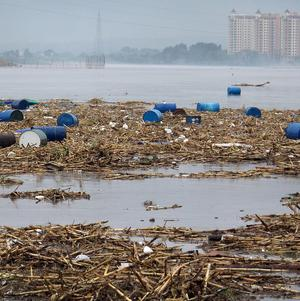 The death toll from China's worst flooding in a decade climbed above 1,000
