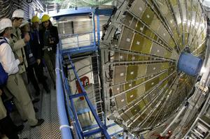 Spectators look at the ATLAS detector construction (a Toroidal LHC Apparatus) at the CERN (Centre Europeen de Recherche Nucleaire) near Geneva, Switzerland, Thursday, May 31, 2007. The detector will be placed around the large hadron collider (LHC), CERN's highest energy particle accelerator. ATLAS is a general-purpose detector designed to measure the broadest possible range of particles and physical processes that could result from the collision of the proton beams within the LHC. A pilot run of the LHC is scheduled for summer 2007. (KEYSTONE/Martial Trezzini)